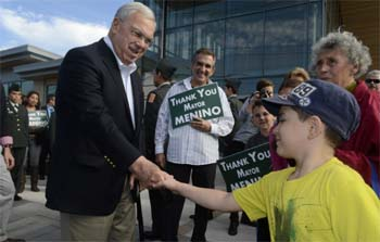 Mayor Thomas Menino greets an East Boston youth outside the new East Boston Branch Library on Bremen Street. Menino was on hand to cut the ribbon on the newly completed library.