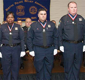 Officers Greta Forbes, Vinny Schettino and Kevin Golden all received the Richard F. Halloran Award for Bravery, a Boston Police Department Medal of Honor, for their actions during a house fire on Maverick Street.